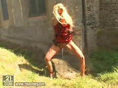 Slutty babe Vega Vixen gets hot and horny in her red dress