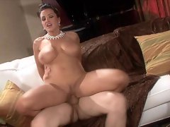 Big boobed Lisa Ann rides her pussy up and down on a hard cock