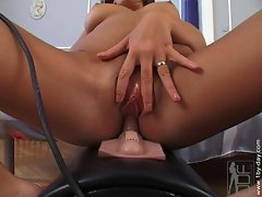 Busty Sandra Shine fucks on a sybian sex toy