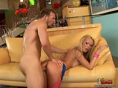 Sexy Nikki Benz has her wet slit pounded by a massive dick on a sofa