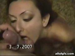 Nasty brunette sucking cock in home video