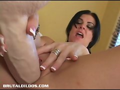 Taryn is stretched out by a brutal dildo