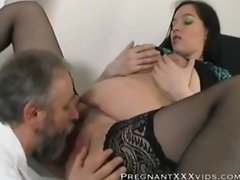 Pregnant brunette keeps her hairy pussy wide open.