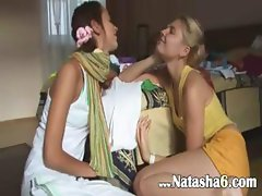 Kissing and teasing of two teenies