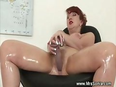 Mature lady rubs her hot body with oil