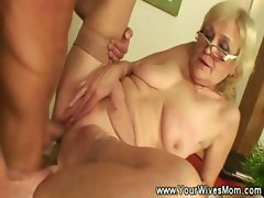 Mature lady enjoys younger cock