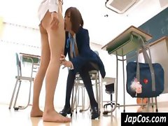 Japanese schoolgirl goes down on his cock and sucks in classroom