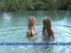Playful lesbian teens in the water