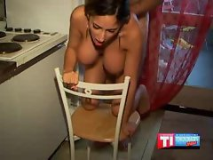 Busty hot latina couple fucking in the kitchen