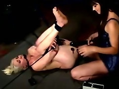 Bounded lesbian slave fights against an orgasm