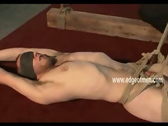 Blindfolded man has the soles of his feet tickled before having his cock teased