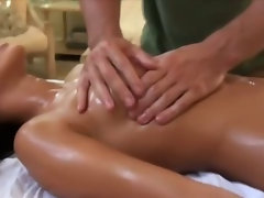 Masseur uses a real massage staff on her wet pussy