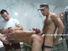 Submissive gay twink gets his ass licked in a public bathroom and is forced to suck dicks