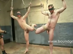 Two slaves endure electric ball crushers