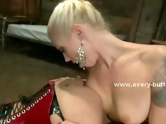 Asian slut has her ass fucked by a giant strapon after being teased by a blonde