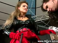 Dominatrix suspending sissy on the air
