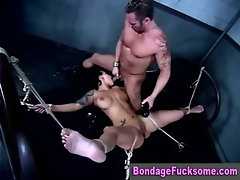 Slut gets roped down on the bed for a hardcore fuck session