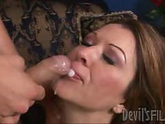 Raquel Devine gets her face sprayed with warm jizz