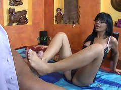 Black Angelica giving a guy a good foot job till he's ready to burst