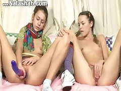 Two portuguese babes dildoing holes