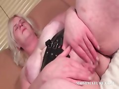 Blonde mature finger fucking her pussy