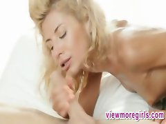 Skinny blonde does footjob and banged hard on a couch