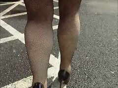 Just fishnet stockings and my coat