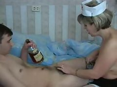 Attractive mature doctor is stroking a dick of her pacient