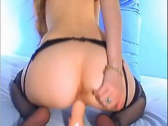 Tina with her toy in her black garter belt