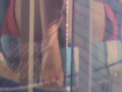 Neighbor showing muff on balcony