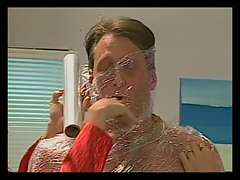 Lad wrapped in saran wrap by sexual gals