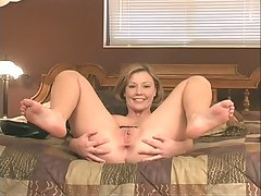 Randy blonde in black stockings  strip-teases on cam