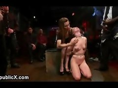 Bound babe gets multiple cumshots in public bar