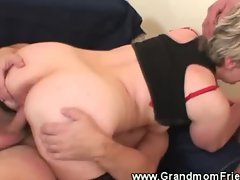Granny rides one cock and sucks the other cock