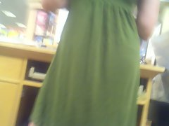 Bookstore worker in green dress