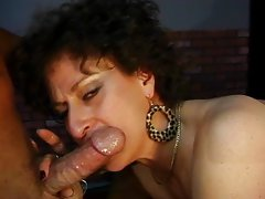 Mature whore sucking dick
