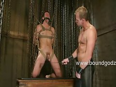 Nick flogs and fucks Shane in bondage