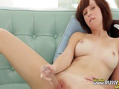Brunette toying her vagina on bedstead
