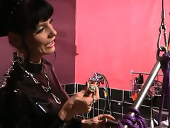 Hardcore fetish femdom scene with man wrapped in plastic