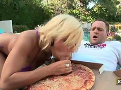 Horny blonde chick sucks a dick sticking out of a pizza