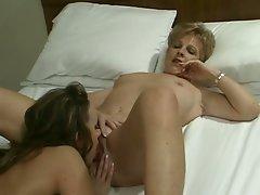 Hungarian babe simony eats older blonde's pussy
