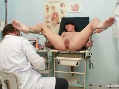 Gyno doctor uses speculum on mature pussy