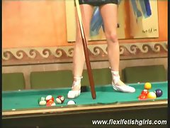 Pool table fun with fexible brunette ballerina