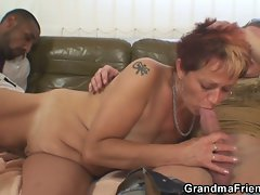 Naughty redheaded granny takes two cocks at once