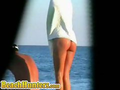 Nudist babe caught on camera in the beach