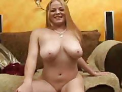 Sexy slut strips and gets on her knees to give head
