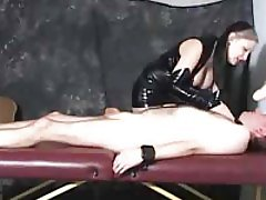 Sexy girl in latex makes him suck a dildo then she gets rough with his cock