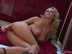 Beautiful blonde using a dildo in her pussy