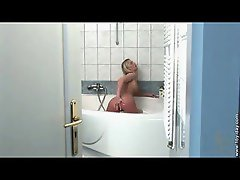Hot blonde working her pussy in the shower