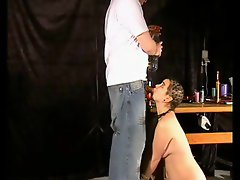 The girl sucks his cock while he cuts and shaves her hair